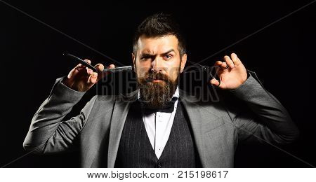 Macho In Formal Suit Cuts And Shaves Beard
