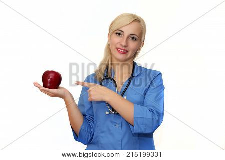 doctor with a dietician showing his finger on a red apple on a white background. Doctor recommends fruit
