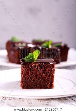 Chocolate cake with chocolate glaze sliced on plate