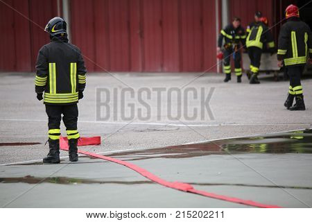 Tired Firefighter After Turning Off The Fire