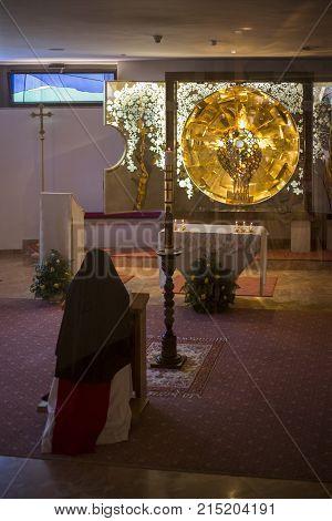 A Catholic nun is praying on her lap at Milk Grotto Church. Bethlehem.