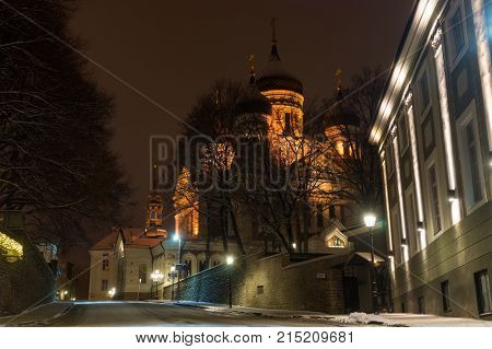 Tallinn OLd Town Street with View on Aleksander Nevski Cathedral at Winter Night, Rstonia.