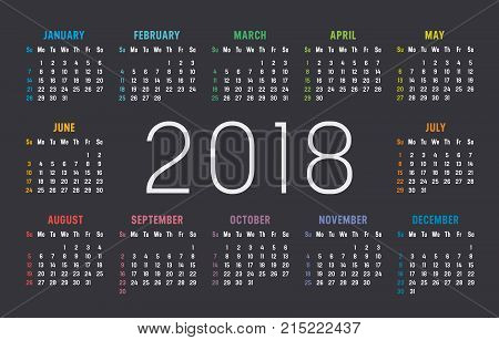 Year 2018 colorful minimalist calendar on black background.