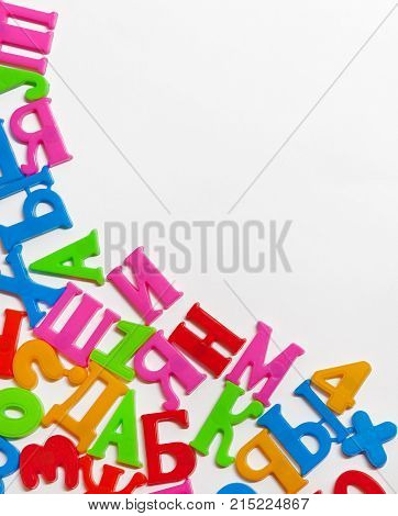 Colored letters and numbers made of plastic on white background