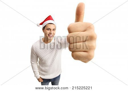 Young man with a christmas hat making a thumb up sign isolated on white background