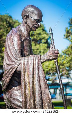 Wellington New Zealand 28 September 2015: life-sized statue of Indian political and spiritual leader Mahatma Gandhi at Wellington railway station by Indian sculptor Gautam Pal.