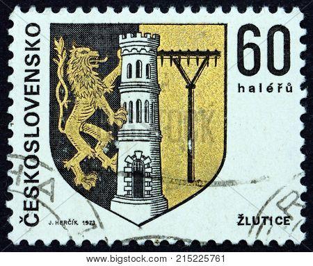 CZECHOSLOVAKIA - CIRCA 1973: a stamp printed in Czechoslovakia shows Zlutice coat of arms circa 1973