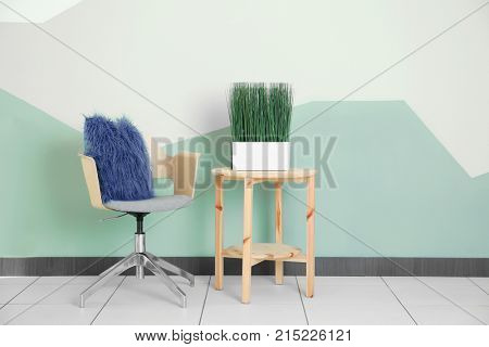 Modern interior with armchair on color wall background