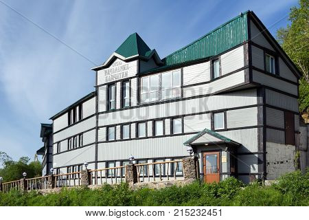PETROPAVLOVSK-KAMCHATSKY CITY KAMCHATKA PENINSULA RUSSIAN FAR EAST - JUNE 16 2017: Summer view of facade building of Hotel Chief of Kamchatka (Nachalnik Kamchatki) in Petropavlovsk-Kamchatsky City.