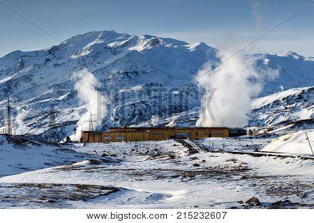 MUTNOVSKY VOLCANO KAMCHATKA PENINSULA RUSSIAN FAR EAST - Oct 22 2017: Winter view on Mutnovskaya Geothermal Power Plant (Mutnovskaya GeoPP-1) Geotherm JSC (RusHydro) at foot of active volcano.