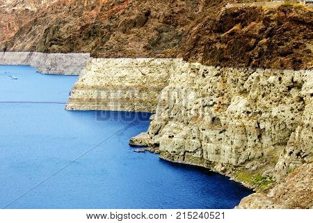 Steep rocky shoreline of Lake Mead seen from the Hoover Dam east of Las Vegas Nevada