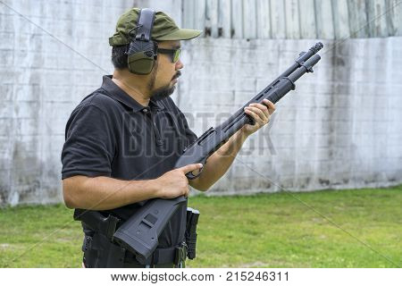 View of a man with a shotgun.