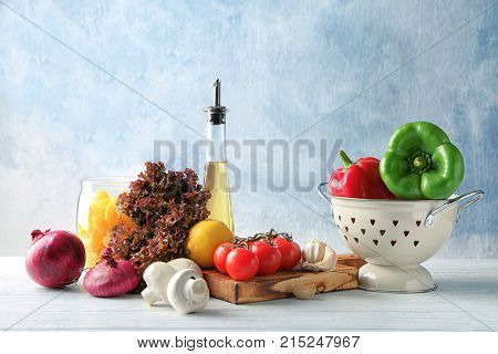 Composition with foodstuff on wooden table poster