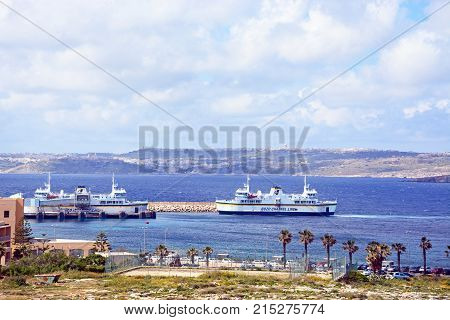 PARADISE BAY, MALTA, APRIL 2, 2017 - Gozo ferry in the ferry terminal with views towards Gozo Paradise Bay Malta Europe, April 2, 2017.