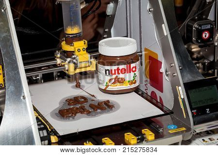 Moscow, Russia - October, 2015: Nutella chocolate 3d printer printing. Close up process of new printing technology