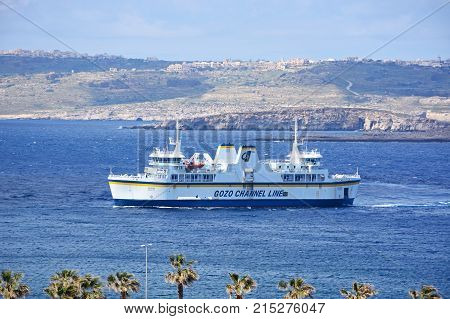 PARADISE BAY, MALTA, APRIL 2, 2017 - Gozo ferry in the bay with views towards Gozo and Comino Paradise Bay Malta Europe, April 2, 2017.