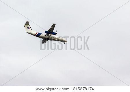 Icelandic Coast Guard Airplane In Gray Sky
