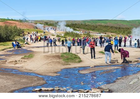 Tourists Near Strokkur Geyser In Haukadalur Area