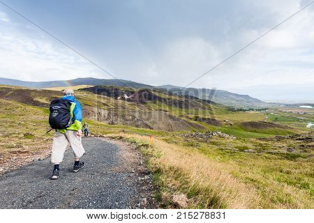 Tourists Hike On Trail In Hveragerdi In Iceland