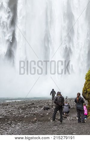 People In Bottom Of Skogafoss Waterfall In Iceland