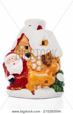 Santa Claus Christmas decoration.. Christmas figurine on isolated white background. Studio photo. Cute.