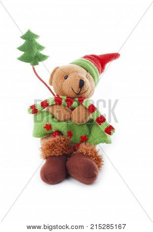 Christmas bear decoration. Cute plush toy decor for christmas. Mini Teddy bear wearing christmas costume. Winter holiday isolated white photo. Christmas concept. Cute.