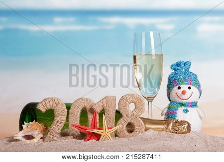 New Year Inscription 2018, Bottle And Glass Of Champagne, Snowman, Starfish And Seashell In The Sand