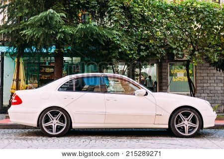 Batumi, Adjara, Georgia - September 7, 2017: Car brand Mercedes-Benz E 320 is parked on a narrow street in the old part of city