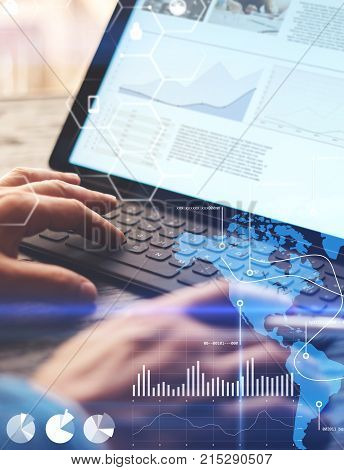 Concept of virtual diagram, graph interfaces, digital display, connections, statistics icons.Man using stylus pencil on display of contemporary electronic tablet.Blurred background. Vertical