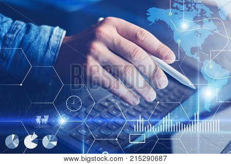 Concept of virtual diagram, graph interfaces, digital display, connections, statistics icons.Male hand using stylus pencil on digital display of contemporary electronic tablet. Horizontal.Cropped