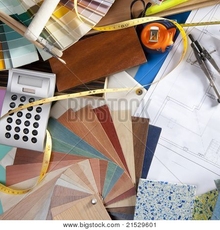 Architect or interior designer workplace desk and design tools with lots of construction material samples