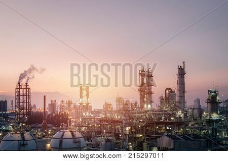 Sunset sky in petrochemical industry view Factory of oil and gas refinery industrial at evening