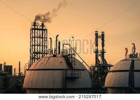 Gas storage sphere tanks in petrochemical industry with sunset sky Close up of petrochemical work site