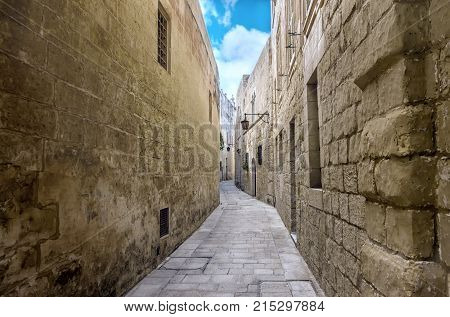 Beautiful View Of Ancient Bleak Narrow Medieval Street In Town Mdina, Malta, Toned Style