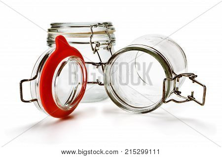 Two empty glass jars isolated on white background