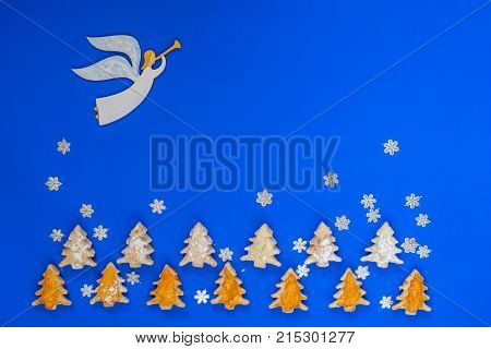 Angel Flies Among The Snowflakes Over The Cookies
