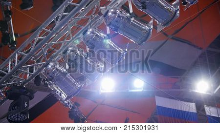 Spotlight. Many spotlights that illuminate the stage at a concert. Stage Spotlight with Laser rays at event conference hall