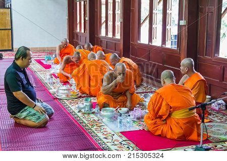 Novice And Monks In Merit Making