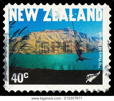 Moscow Russia - November 25 2017: A stamp printed in New Zealand shows bungee jumping in Queenstown series