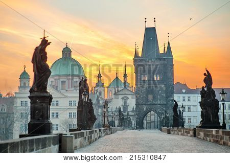 Charles Bridge (Karluv Most) and Lesser Town Tower scenic view at sunrise Prague Czech Republic Europe