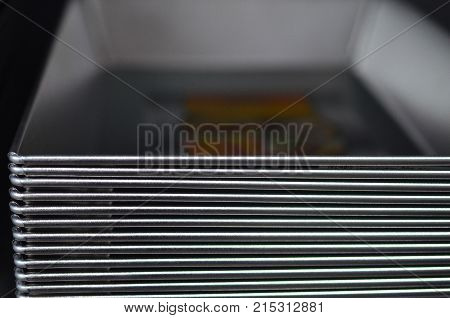 A stack of shiny metal trays for the kitchen