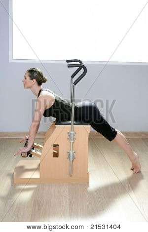 combo wunda pilate chair with woman doing fitness yoga exercise