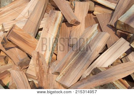 Firewood background - chopped firewood on a stack. Dry chopped firewood logs in a pile. pile of split firewood fuel material