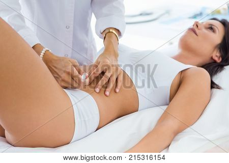 Surgeon Making Injection Into Female Body. Liposuction Concept.