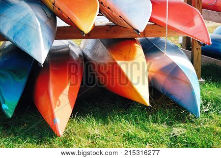 Pile of canoe bright beautiful colored canoes
