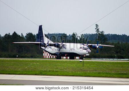 Minsk Minsk National Airport Belarus - September 08 2017: Landing of Antonov An-12 EW-485TI Ruby Star
