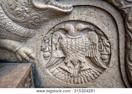 Stone emblem of Gandaberunda or Berunda Pakshiya in Buddha Tooth Relic Temple in Kandi, Sri Lanka