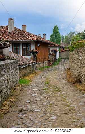 A street in Zheravna village (Municipality of Kotel) with old traditional houses Bulgaria