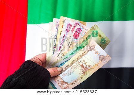 Hand Holding United Arab Emirates Dirhams
