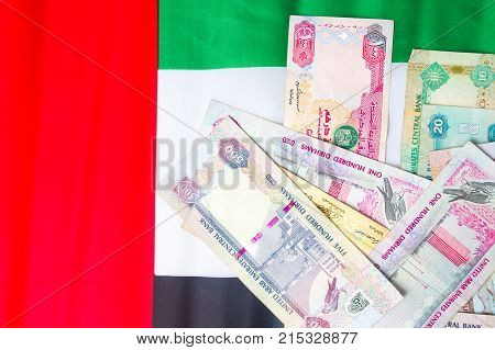 United Arab Emirates Currency On Top Of Flag